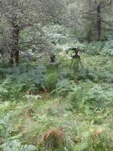 2 figures in woods
