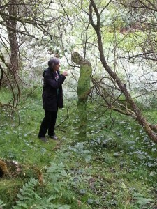 mum and figure in woods