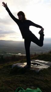 dancer yoga posture,up Moncreiffe Hill, near Perth, Scotland