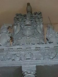Heraldry above the Hay Monument, showing fruit, and flowers and unicorns